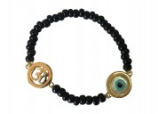 Om & evil eye charm in gold on black beads for new
