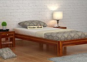 Get big discount on wooden beds at wooden street