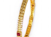 Look simply gorgeous with this polki bangle