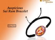 Auspicious sai ram bracelet in gold with rubies